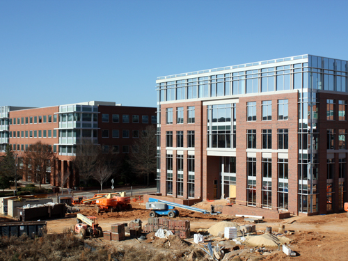 Alliance Center One with Venture II, the Institute's present location, in the background