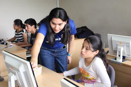 Andrea Villanes with a student at PyCamp Teen Perú